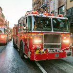 Fire engines driving on the streets of Manhattan, New York